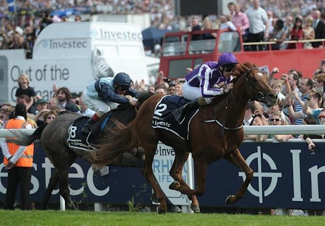Joseph O'Brien rides Australia (R) to victory in the Derby on Derby Day during the Epsom Derby Festival, in Surrey, on June 7, 2014 (AFP Photo/Carl Court)