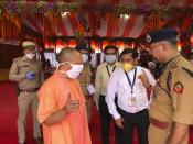 Chief Minister of Uttar Pradesh state Yogi Adityanath inspects the site for a groundbreaking ceremony of a temple dedicated to the Hindu god Ram in Ayodhya, India, Wednesday, Aug. 5, 2020. The coronavirus is restricting a large crowd, but Hindus were joyful before Prime Minister Narendra Modi breaks ground Wednesday on a long-awaited temple of their most revered god Ram at the site of a demolished 16th century mosque in northern India. (AP Photo/Rajesh Kumar Singh)