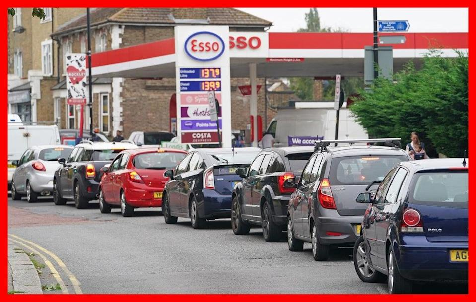 Motorists queue for petrol at an Esso petrol station in Brockley, south London (PA) (PA Media)