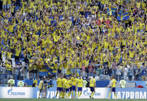 Sweden's Andreas Granqvist, center, celebrates after scoring with his teammates a penalty kick during the group F match between Sweden and South Korea at the 2018 soccer World Cup in the Nizhny Novgorod stadium in Nizhny Novgorod, Russia, Monday, June 18, 2018. (AP Photo/Lee Jin-man)