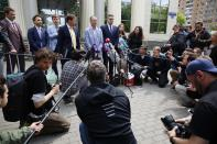 Russian lawyer Ivan Pavlov, center, speaks to the media as other lawyers stand around him during a break in a court session in front of Moscow Court in Moscow, Russia, Wednesday, June 9, 2021. A court is expected to outlaw the organizations founded by Russian opposition leader Alexei Navalny. Prosecutors have asked the Moscow City Court to designate Navalny's Foundation for Fighting Corruption and his sprawling network of regional offices as extremist organizations. The extremism label also carries lengthy prison terms for activists who have worked with the organizations, anyone who donated to them, and even those who simply shared the groups' materials. (AP Photo/Alexander Zemlianichenko)