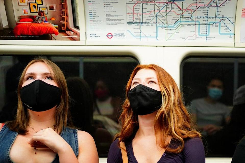 Facemasks were made mandatory for travelling on public transport in England in June, but it was not until July that they were required inside shops (Victoria Jones/PA) (PA Wire)