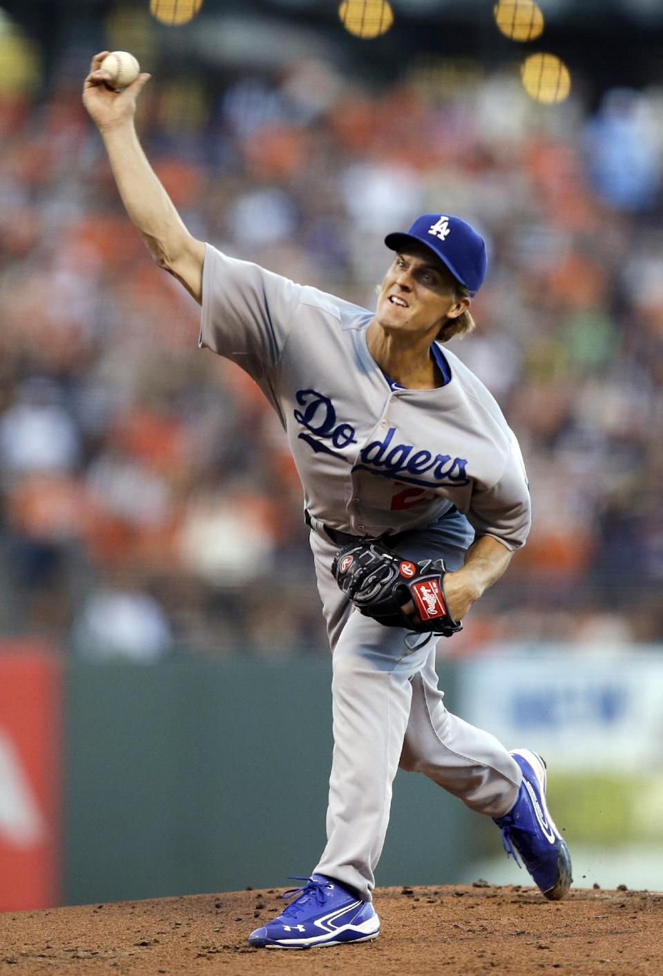 Los Angeles Dodgers pitcher Zack Greinke works against the San Francisco Giants in the first inning of a baseball game Friday, July 25, 2014, in San Francisco. (AP Photo)