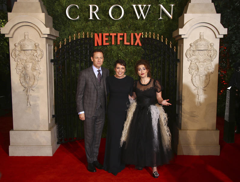Tobias Menzies, Olivia Colman and Helena Bonham Carter pose for photographers upon arrival at the world premiere of 'The Crown' season 3. (Photo by Joel C Ryan/Invision/AP)