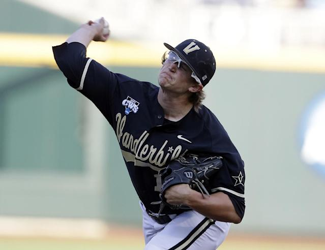 Vanderbilt's Carson Fulmer throws a pitch in the first inning of Game 3 of the best-of-three NCAA baseball College World Series finals against Virginia, in Omaha, Neb., Wednesday, June 25, 2014. (AP Photo/Nati Harnik)