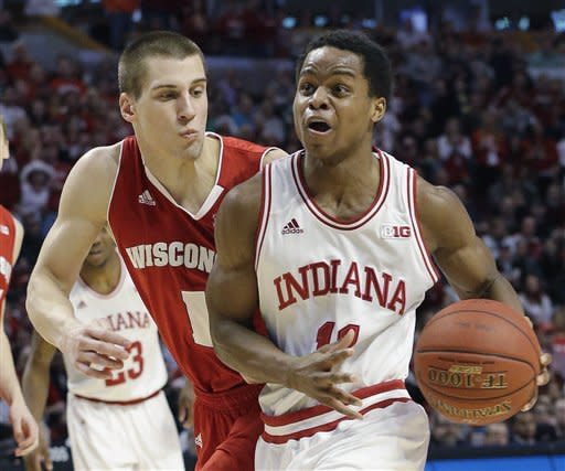 Indiana's Yogi Ferrell tries to drive past Wisconsin's Ben Brust (1) during the second half of an NCAA college basketball game at the Big Ten tournament Saturday, March 16, 2013, in Chicago. (AP Photo/Nam Y. Huh)