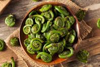 "<p>You can find fiddleheads, sometimes called <a href=""https://www.thedailymeal.com/cook/what-are-fiddleheads?referrer=yahoo&category=beauty_food&include_utm=1&utm_medium=referral&utm_source=yahoo&utm_campaign=feed"" rel=""nofollow noopener"" target=""_blank"" data-ylk=""slk:fiddlehead ferns"" class=""link rapid-noclick-resp"">fiddlehead ferns</a>, at farmers markets in the spring, from late April to early June. It's a short season, so if you see these, snatch them up. They taste a bit like asparagus, with a hint of spinach and nuttiness. Highlight them by <a href=""https://www.thedailymeal.com/recipes/fiddlehead-ferns-pine-nuts-pecorino-and-lemon-zest-recipe?referrer=yahoo&category=beauty_food&include_utm=1&utm_medium=referral&utm_source=yahoo&utm_campaign=feed"" rel=""nofollow noopener"" target=""_blank"" data-ylk=""slk:blanching them and sauteing them simply with pine nuts, garlic, lemon and Pecorino"" class=""link rapid-noclick-resp"">blanching them and sauteing them simply with pine nuts, garlic, lemon and Pecorino</a>.</p>"