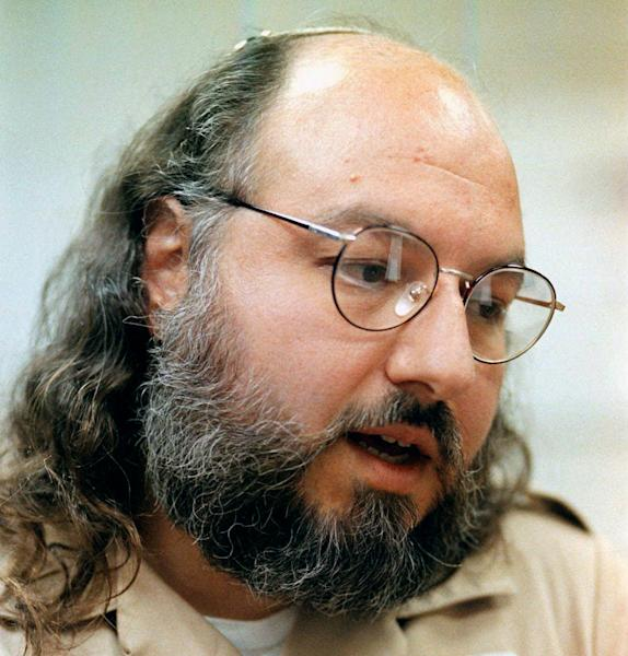 FILE - This May 15, 1998 file photo shows Jonathan Pollard speaking during an interview in a conference room at the Federal Correction Institution in Butner, N.C. An AP source says: the US is talking with Israel about early release of Pollard for concessions. (AP Photo/Karl DeBlaker, File)