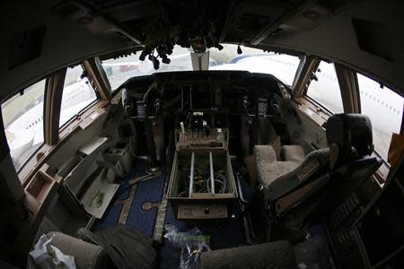 A view of the cockpit inside a Boeing 747 set to be dismantled in the recycling yard of Air Salvage International (ASI) in Kemble, central England November 27, 2013. REUTERS/Stefan Wermuth