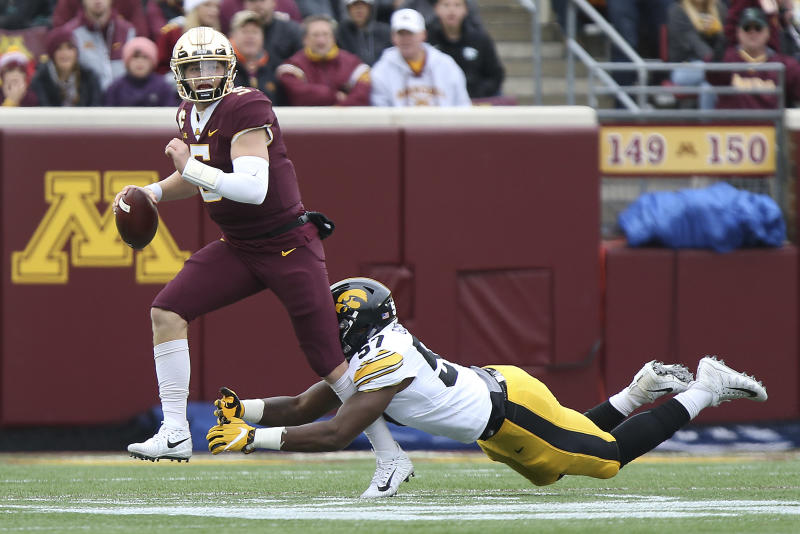 Minnesota quarterback Zack Annexstad tries to avoid a tackle by Iowa's Chauncey Golston during an NCAA college football game Saturday, Oct. 6, 2018, in Minneapolis. (AP Photo/Stacy Bengs)