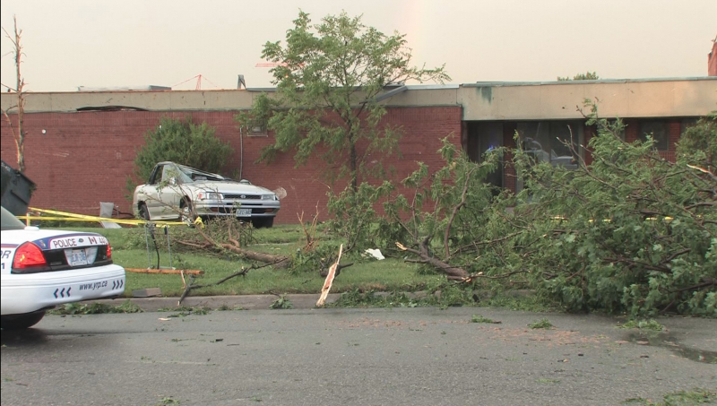 WIki Creative Commons: Vaughan Tornado, 2009. Theonlysilentbob. Link: https://commons.wikimedia.org/wiki/Category:Southern_Ontario_Tornado_Outbreak_of_2009#/media/File:Crushed_car_tornado_aftermath_on_the_lawn_of_a_school_in_Woodbridge.jpg