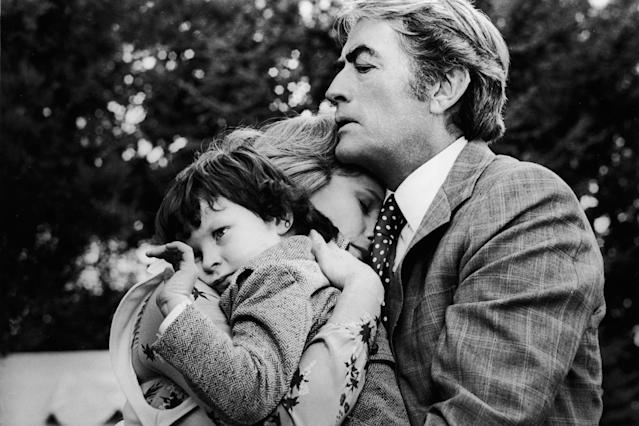 Gregory Peck and Lee Remick embrace Harvey Stephens in ' <i>The Omen'</i> (Photo: 20th Century Fox/Getty Images)