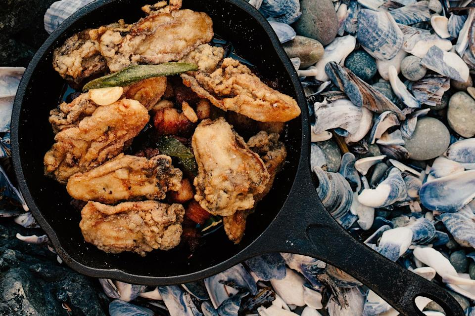"""Fry oysters in a combo of butter and bacon fat, then top with fried sage and crumbled bacon for an appetizer that'll finally teach you what it means to be living. <a href=""""https://www.epicurious.com/recipes/food/views/fried-oysters-with-bacon-garlic-and-sage?mbid=synd_yahoo_rss"""" rel=""""nofollow noopener"""" target=""""_blank"""" data-ylk=""""slk:See recipe."""" class=""""link rapid-noclick-resp"""">See recipe.</a>"""