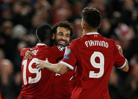 Soccer Football - Champions League Semi Final First Leg - Liverpool vs AS Roma - Anfield, Liverpool, Britain - April 24, 2018 Liverpool's Sadio Mane celebrates scoring their third goal with Mohamed Salah and Roberto Firmino REUTERS/Phil Noble