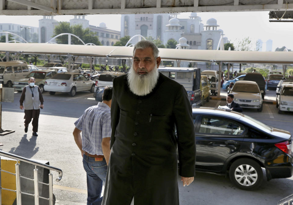 Rai Bashir, a defense lawyer for one of the suspects in Daniel Pearl murder case, arrives at the Supreme Court for an appeal hearing in the Pearl case, in Islamabad, Pakistan, Wednesday, Oct. 7, 2020. Ahmed Omar Saeed Sheikh, a British-born Pakistani who has been on death row over the 2002 killing of U.S. journalist Pearl, will remain in jail for another three months under a government order, a prosecutor told the country's top court Wednesday. (AP Photo/Anjum Naveed)