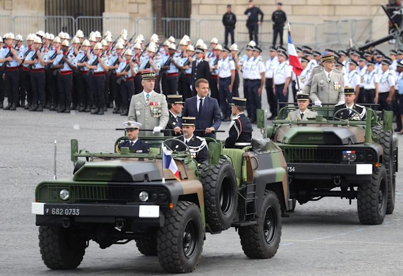 French President Emmanuel Macron (R) arrives with chief of the defence staff, General Francois Lecointre, prior to the annual Bastille Day military ceremony.