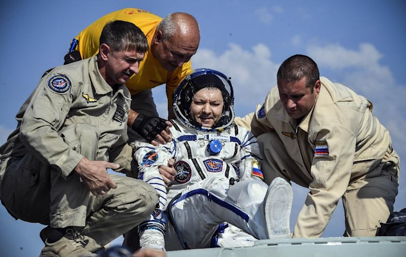 "Russian cosmonaut Oleg Kononenko joked that he was ""happy to see any kind of weather"" after coming back from space (AFP Photo/Alexander NEMENOV)"