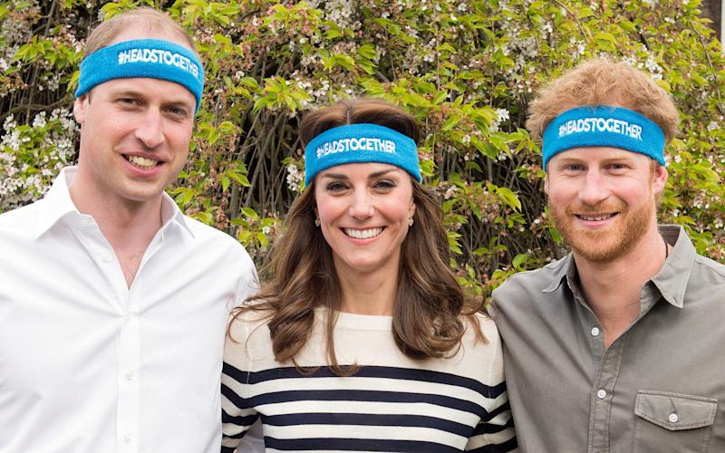 The Duke and Duchess of Cambridge and Prince Harry in their Heads Togther marathon bands - Credit: Getty