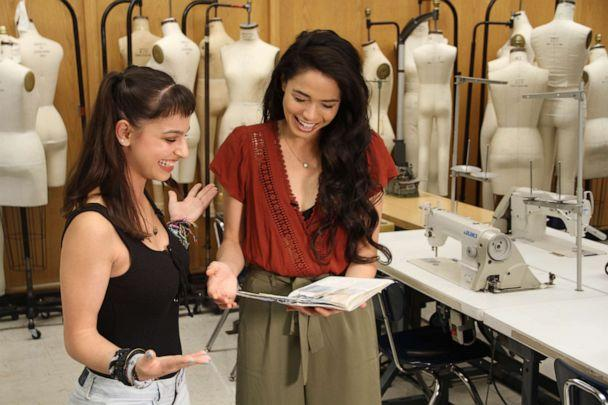 PHOTO: Annette Stone (FIT student) and Arielle Jacobs (Jasmine, 'Aladdin') review design sketches for Jasmine inspired garments. (Disney)