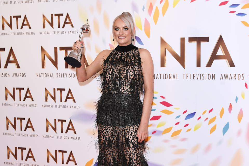 """LONDON, ENGLAND - JANUARY 28:  Katie McGlynn, winner of the Drama Performance award for """"Coronation Street"""", poses in the winners room at the National Television Awards 2020 at The O2 Arena on January 28, 2020 in London, England. (Photo by David M. Benett/Dave Benett/Getty Images)"""