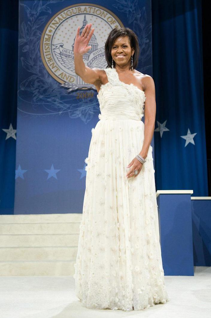 Michelle Obama waves at her husband's first inaugural ball.