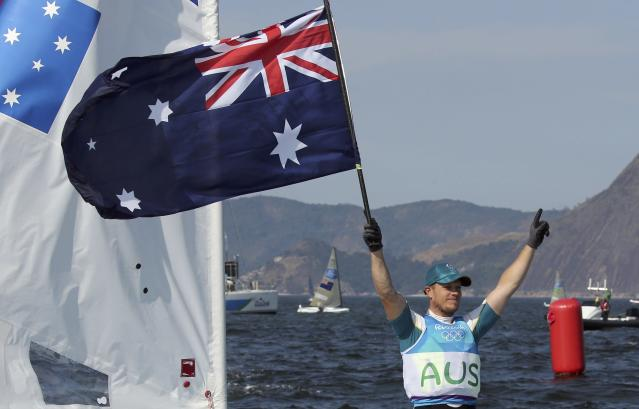 2016 Rio Olympics - Sailing - Final - Men's One Person Dinghy - Laser - Medal Race - Marina de Gloria - Rio de Janeiro, Brazil - 16/08/2016. Tom Burton (AUS) of Australia celebrates gold medal. REUTERS/Benoit Tessier FOR EDITORIAL USE ONLY. NOT FOR SALE FOR MARKETING OR ADVERTISING CAMPAIGNS.