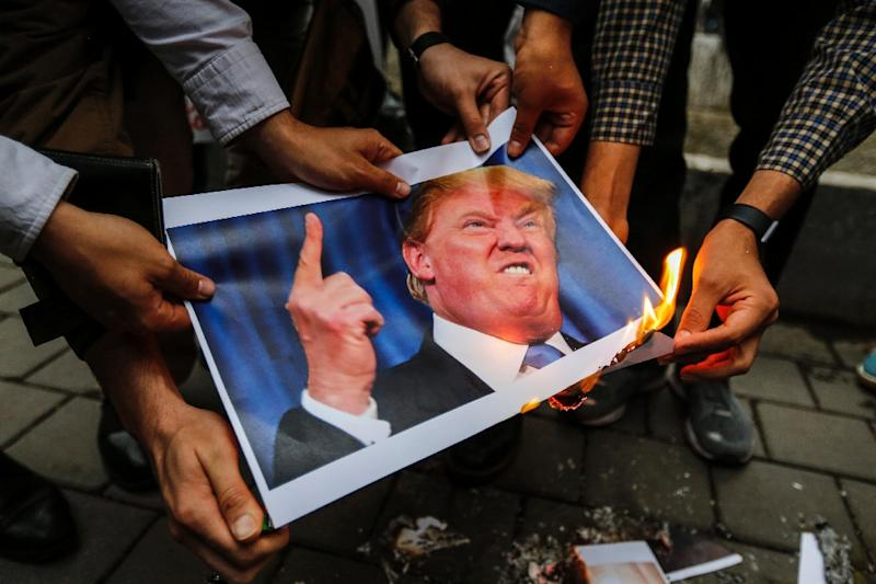 Iranians burn an image of President Donald Trump during an anti-US demonstration in Tehran on May 9, 2018