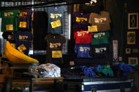 In this Oct. 26, 2020, photo, merchandise which would be for sale is seen inside Tipitina's music club, closed due to the COVID-19 pandemic, in New Orleans. Music clubs all over the nation — pop culture icons like the Troubadour in West Hollywood, the Bluebird Cafe in Nashville, The Bitter End in New York's Greenwich Village — are shuttered. And owners fear for the future of their businesses and of a musical way of life. (AP Photo/Gerald Herbert)