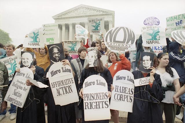 """<span class=""""s1"""">Demonstrators gathered outside the Supreme Court in April 1992 as the court heard arguments over a restrictive Pennsylvania abortion statute. (Photo: Greg Gibson/AP)</span>"""