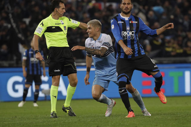 Lazio's Joaquin Correa, center, celebrates after scoring his side's second goal during the Italian Cup soccer final match between Lazio and Atalanta, at the Rome Olympic stadium, Wednesday, May 15, 2019. (AP Photo/Alessandra Tarantino)