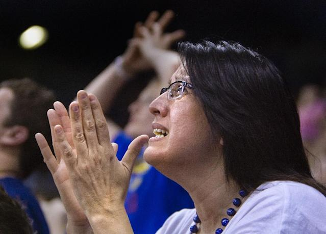 Maritza Vazquez reacts as Kentucky pulls ahead of Kansas in the NCAA men's college basketball tournament Final Four championship game in New Orleans, as fans watch the broadcast of the game at Allen Fieldhouse on Monday night, April 2, 2012, in Lawrence, Kan. Kentucky defeated Kansas 67-59. (AP Photo/The Kansas City Star, Allison Long)