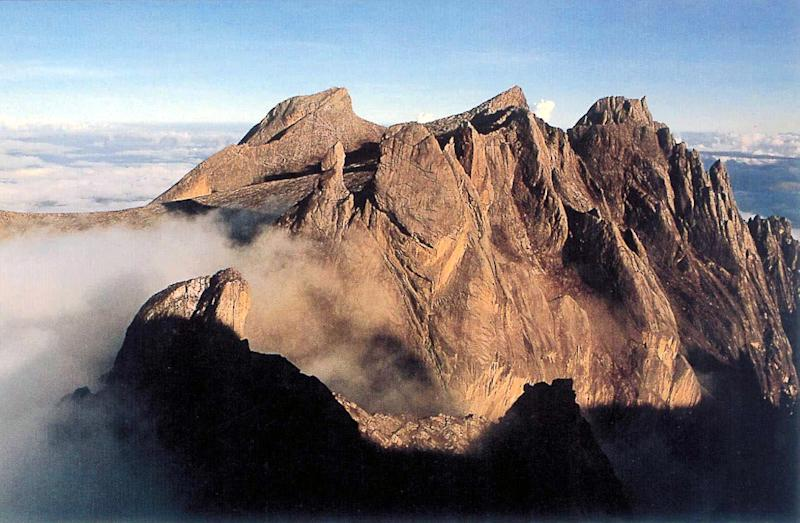 A strong earthquake that jolted Malaysia's Mount Kinabalu has killed at least 11 people and left another eight missing on Southeast Asia's highest peak, a government official says (AFP Photo/)