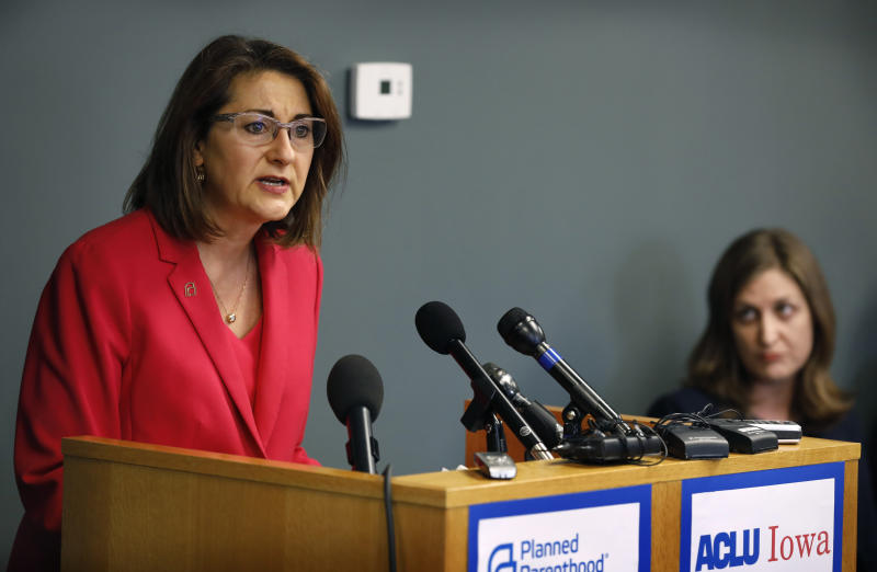 Planned Parenthood of the Heartland President and CEO Suzanna de Baca speaks during a news conference, Tuesday, May 15, 2018, in Des Moines, Iowa. Planned Parenthood and the American Civil Liberties Union said Tuesday that they had filed a lawsuit challenging the nation's most restrictive abortion law, an Iowa provision that bans most abortions once a fetal heartbeat is detected, around the sixth week of pregnancy. (AP Photo/Charlie Neibergall)