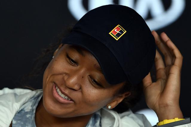 Naomi Osaka has learned to deal with the increased media coverage that comes with winning. (Photo by MANAN VATSYAYANA/AFP via Getty Images)