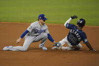 Tampa Bay Rays' Randy Arozarena gets tagged out stealing by Los Angeles Dodgers second baseman Enrique Hernandez during the first inning in Game 4 of the baseball World Series Saturday, Oct. 24, 2020, in Arlington, Texas. (AP Photo/Eric Gay)
