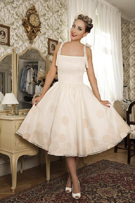 """<div class=""""caption-credit""""> Photo by: Dolly Couture</div>Go for pin-up girl styles, like halters and tea-length skirts. <br> <a rel=""""nofollow noopener"""" href=""""http://lover.ly/explore?q=short+wedding+dress&utm_source=shine08-20-13rockabilly&utm_medium=guest&utm_campaign=shine08-20-13rockabilly"""" target=""""_blank"""" data-ylk=""""slk:Short wedding dresses"""" class=""""link rapid-noclick-resp"""">Short wedding dresses</a> <br> The Black Label New Orleans From <a rel=""""nofollow noopener"""" href=""""http://r.lover.ly/redir.php/jdrTjKJhNxc_aHR0cDovL2RvbGx5Y291dHVyZS5jb20vY29sbGVjdGlvbi9ibGFjay1sYWJlbC5odG1s"""" target=""""_blank"""" data-ylk=""""slk:Dolly Couture"""" class=""""link rapid-noclick-resp"""">Dolly Couture</a> via <a rel=""""nofollow noopener"""" href=""""http://lover.ly/image/306492"""" target=""""_blank"""" data-ylk=""""slk:Lover.ly"""" class=""""link rapid-noclick-resp"""">Lover.ly</a>"""