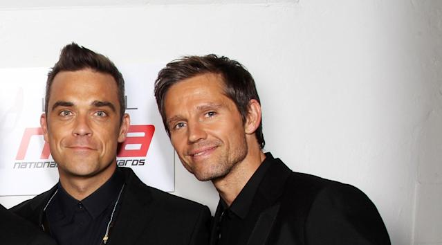 Take That's Robbie Williams and Jason Orange in 2011 (Getty Images)