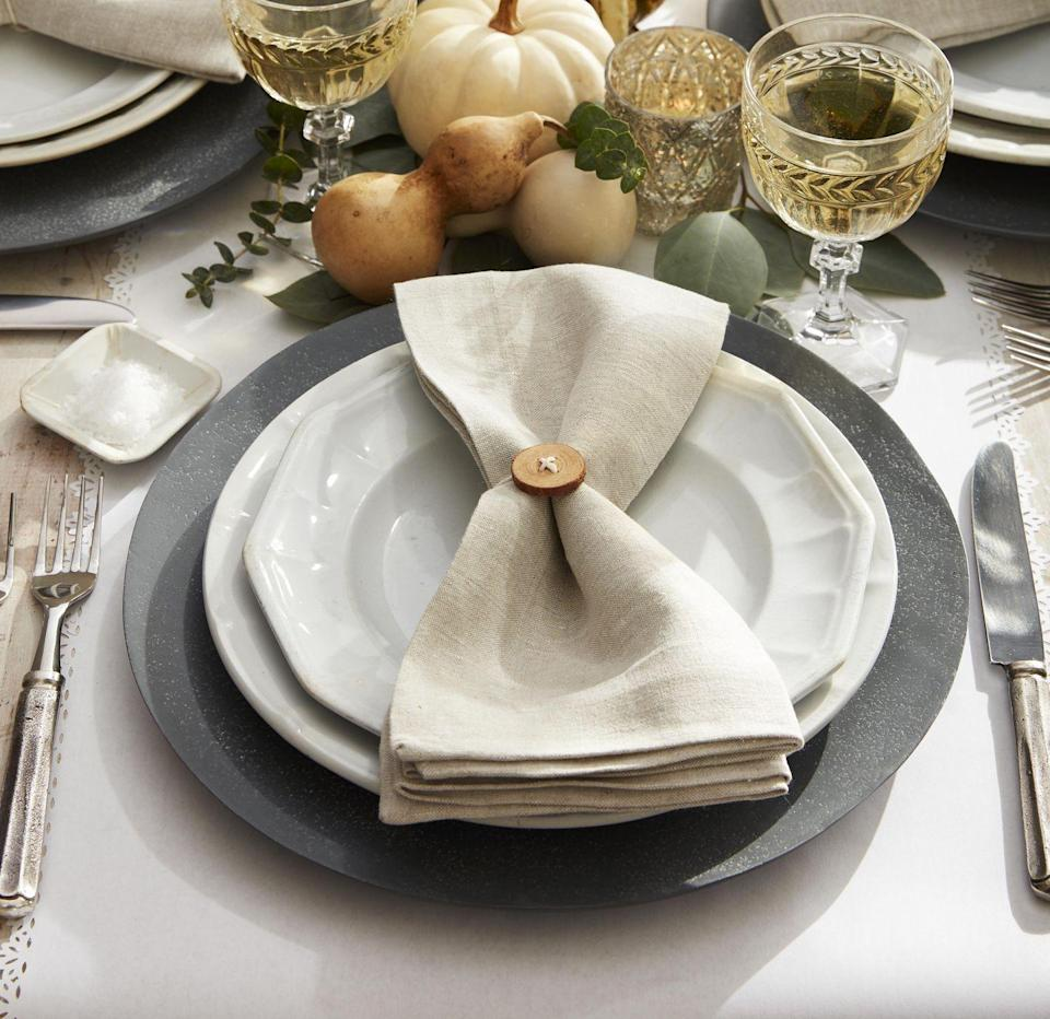"""<p>This neutral toned place setting is just cute as a button! To make either buy would buttons or drill small holes into small wood rounds. Thread holes with white twine and tie around napkins.</p><p><a class=""""link rapid-noclick-resp"""" href=""""https://www.amazon.com/PEPPERLONELY-Coffee-Buttons-Scrapbooking-Sewing/dp/B00O4WN674/ref=sr_1_1?tag=syn-yahoo-20&ascsubtag=%5Bartid%7C10050.g.1371%5Bsrc%7Cyahoo-us"""" rel=""""nofollow noopener"""" target=""""_blank"""" data-ylk=""""slk:SHOP WOOD BUTTONS"""">SHOP WOOD BUTTONS</a></p>"""