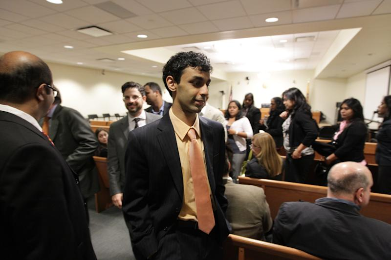 Dharun Ravi walks out of the courtroom after the judge answered a jury during his trial  at the Middlesex County Courthouse in New Brunswick.   Ravi, 20, is accused of using a webcam for the central crime, then using Twitter, instant messages and texts to tell friends about it. He's charged with 15 criminal counts, including bias intimidation and invasion of privacy. His roommate, Tyler Clementi, committed suicide in September 2010, just days after the alleged spying. (AP Photo/The Star-Ledger, John O'Boyle, Pool)