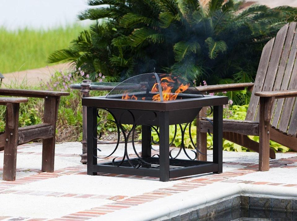 <p>Your fire will burn all night long with this <span>Hammer Tone Bronze Finish Cocktail Table Fire Pit</span> ($195). Keep additional logs on the bottom shelf.</p>