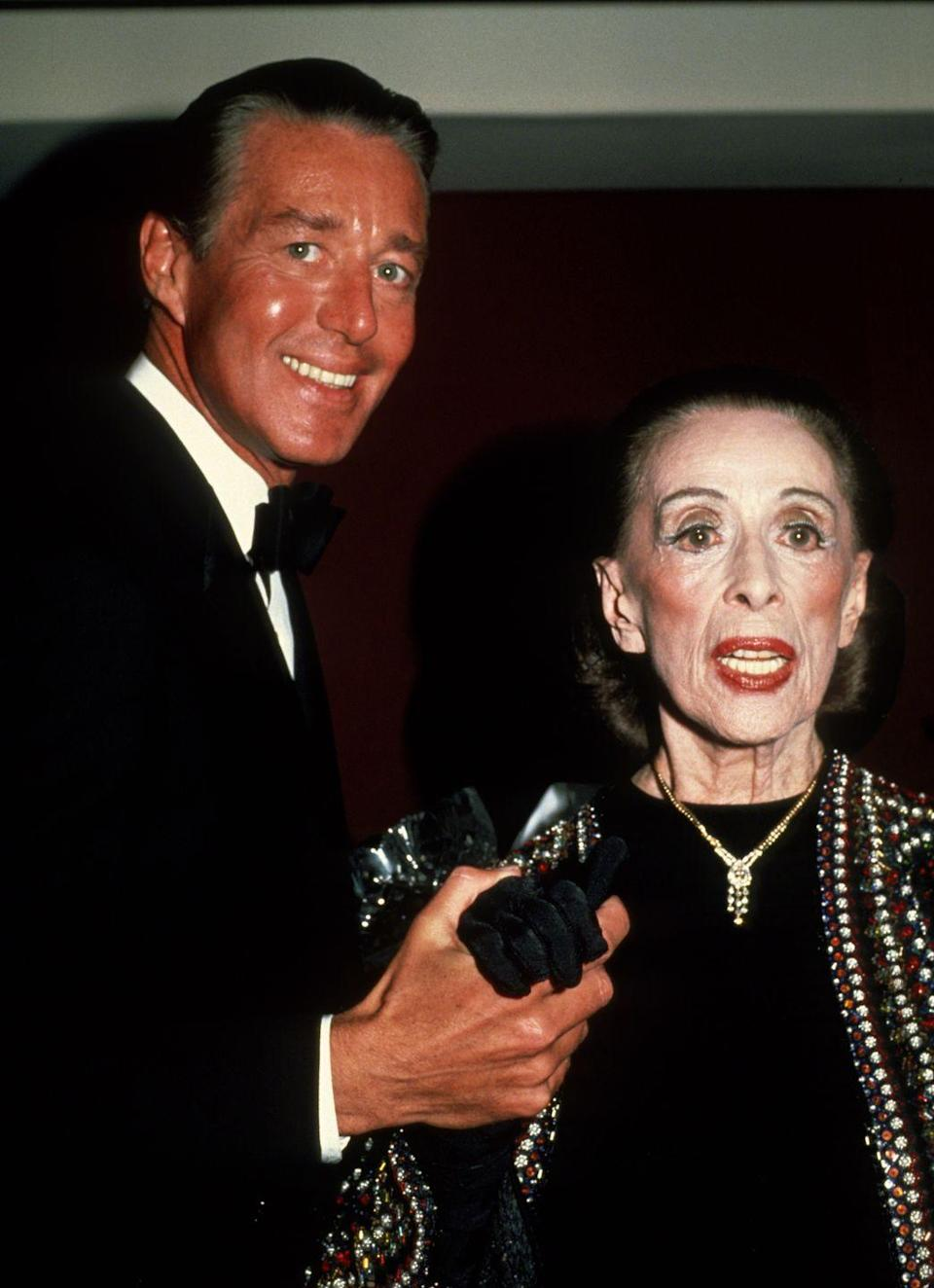<p>Halston and iconic dancer Martha Graham are pictured here at an event. The pair collaborated on costumes for Graham's dance productions. </p>