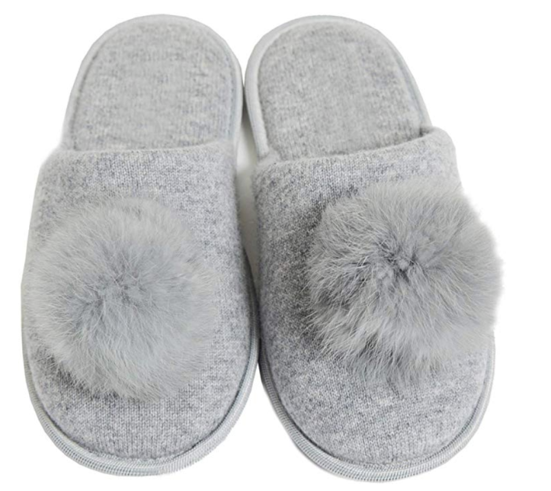 Cashmere slippers with a fur pom-pom? You deserve a pair too. (Photo: Amazon)