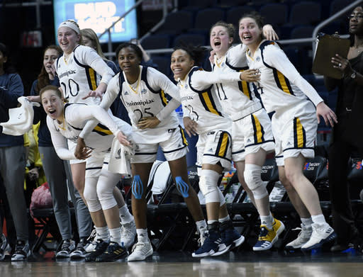 Quinnipiac players celebrate their win over Marist during the championship NCAA college basketball game during the Metro Atlantic Athletic Conference women's tournament, Monday, March 11, 2019, in Albany, N.Y. (AP Photo/Hans Pennink)