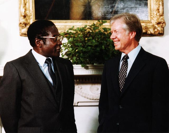 <p>President Jimmy Carter meets with Robert Mugabe, prime minister of the newly independent Zimbabwe, Aug. 27, 1980. (Photo: Corbis via Getty Images) </p>