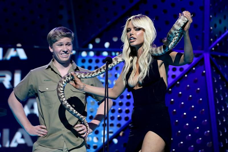 Robert Irwin and Sophie Monk hold a python during the 33rd Annual ARIA Awards 2019 at The Star on November 27, 2019 in Sydney, Australia.