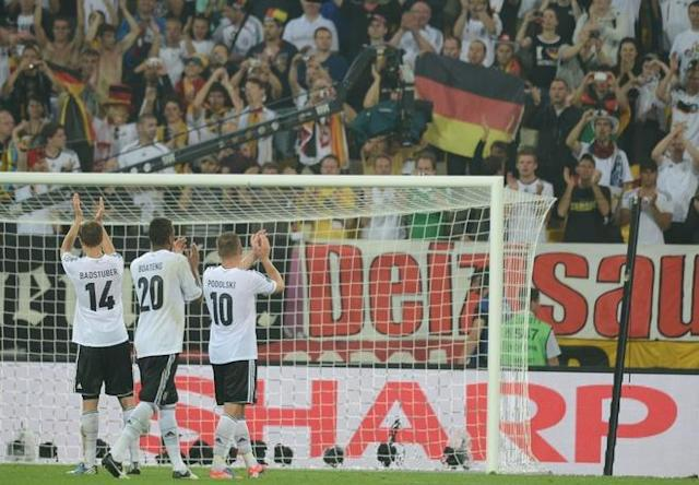 German defender Holger Badstuber (L) German defender Jerome Boateng(2ndL) and German forward Lukas Podolski applaud their fans at the end of the Euro 2012 championships football match Germany vs Portugal on June 9, 2012 at the Arena Lviv. Germany won 1-0. AFP PHOTO / JEFF PACHOUDJEFF PACHOUD/AFP/GettyImages