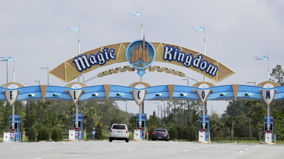 Park guests enter the Magic Kingdom during the reopening of Walt Disney World, Saturday, July 11, 2020, in Lake Buena Vista, Fla. (AP Photo/John Raoux)