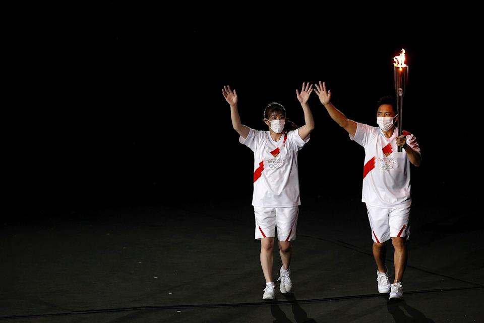 The Olympic flame enters the stadium during the opening ceremony.