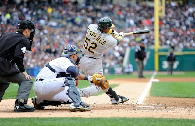 DETROIT, MI - OCTOBER 07: Yoenis Cespedes #52 of the Oakland Athletics hits a RBI single in the top of the third inning to drive in Cliff Pennington #2 against the Detroit Tigers during Game Two of the American League Division Series at Comerica Park on October 7, 2012 in Detroit, Michigan. (Photo by Jason Miller/Getty Images)