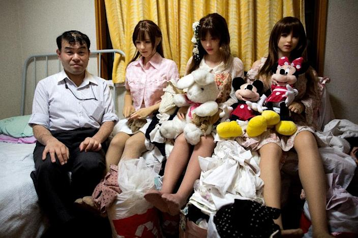 """""""I can't imagine going back to a human being,"""" says physiotherapist Masayuki Ozaki, who takes his dolls on dates in a wheelchair and dresses them in wigs, sexy clothes and jewelry. (AFP Photo/Behrouz MEHRI)"""